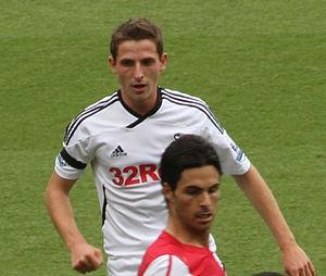 Joe Allen and Ashley Williams of Swansea defen...