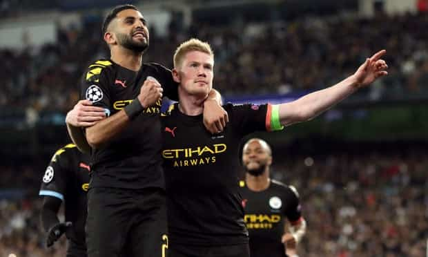 Kevin De Bruyne celebrates with Riyad Mahrez after scoring Manchester City's second and decisive goal at Real Madrid